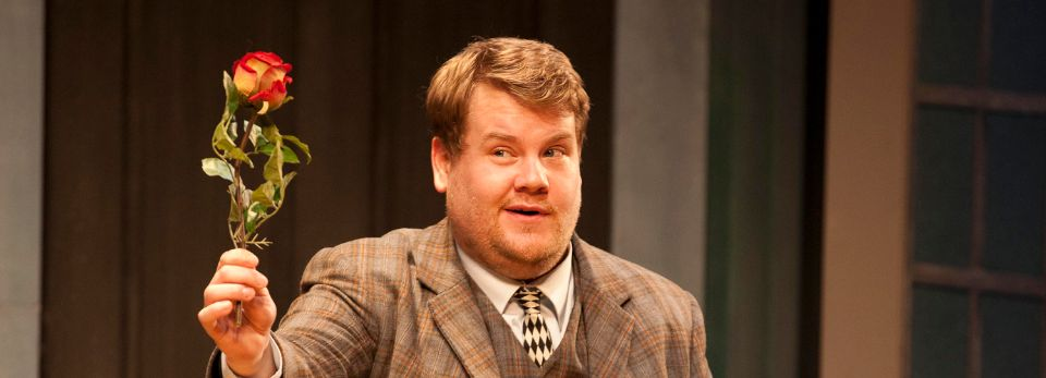 James Corden in One Man, Two Guvnors, holding a rose.