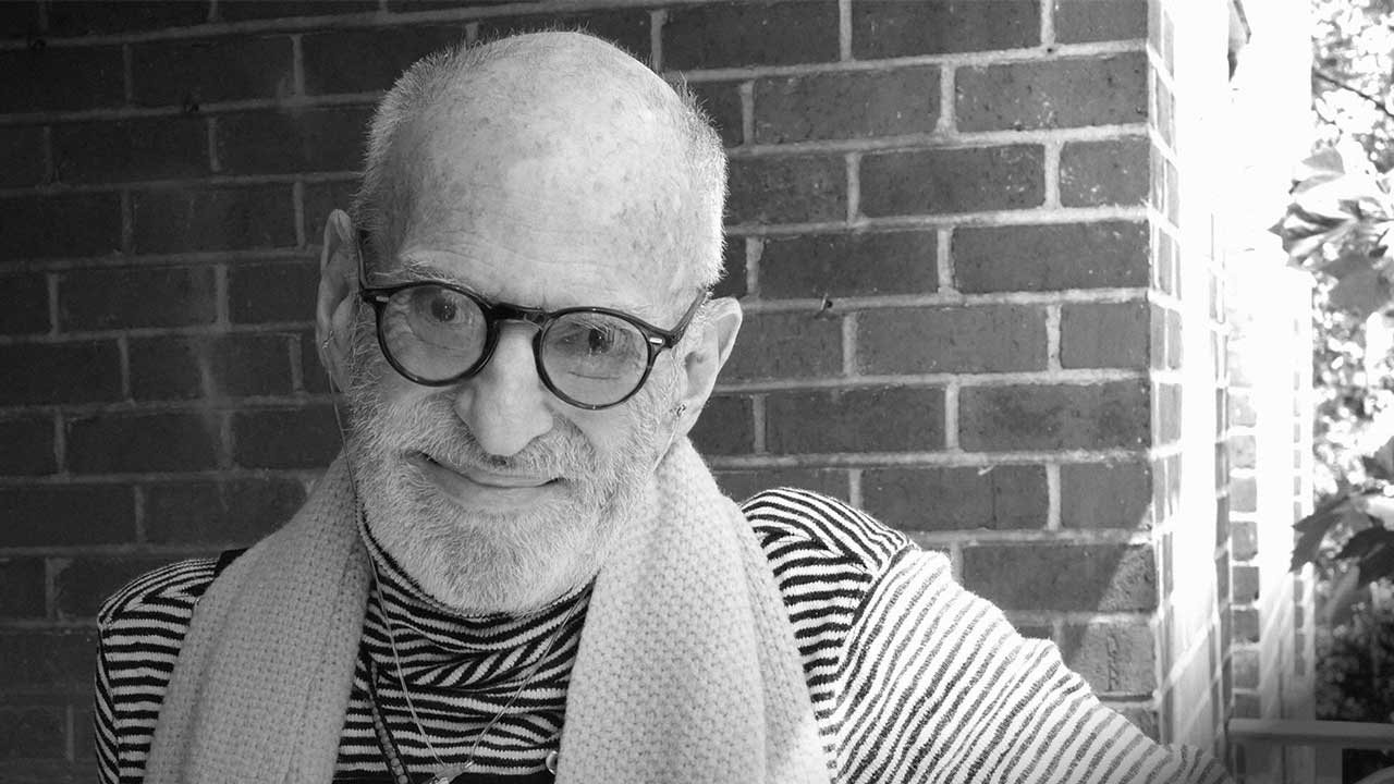 A black and white photograph of author and activist Larry Kramer.