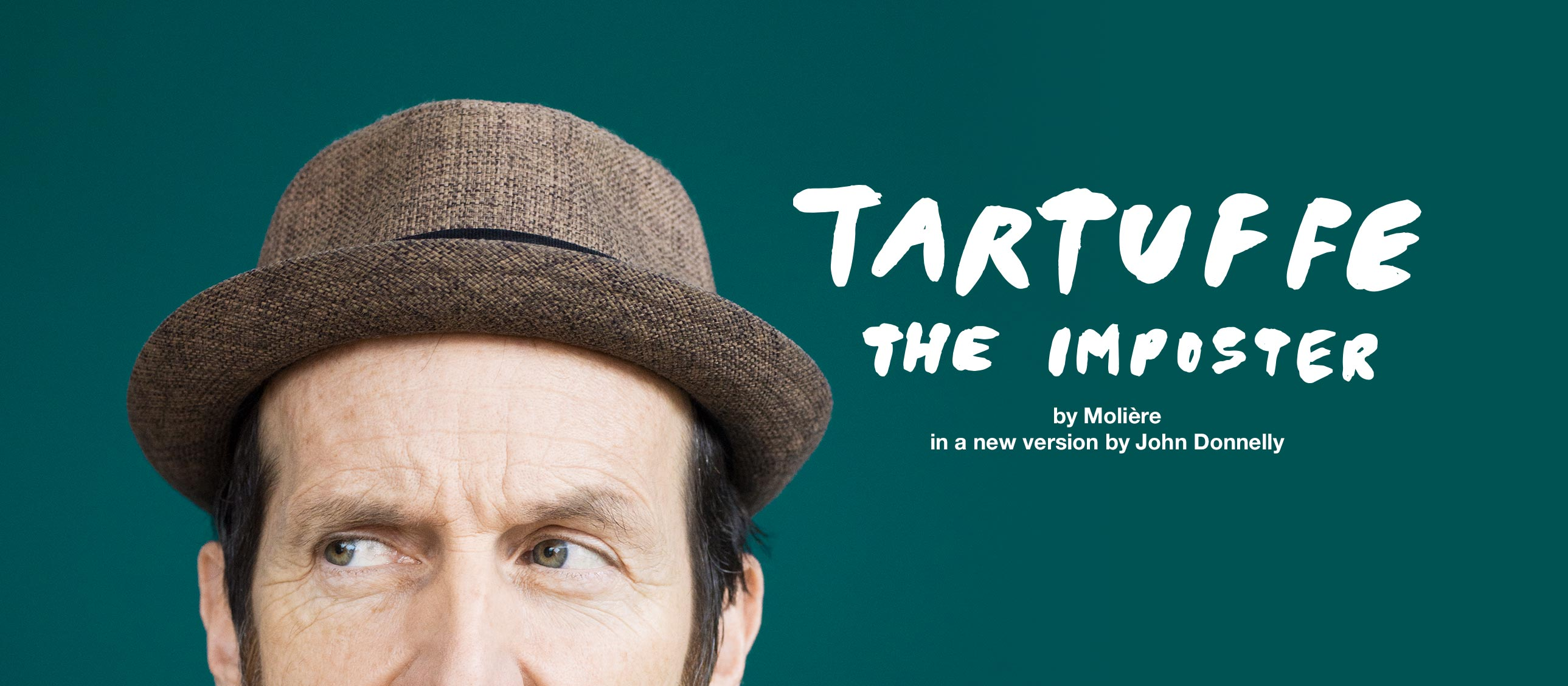 Tartuffe poster - portrait of Denis O'Hare as Tartuffe, with his eyes, forehead and a trilby hat