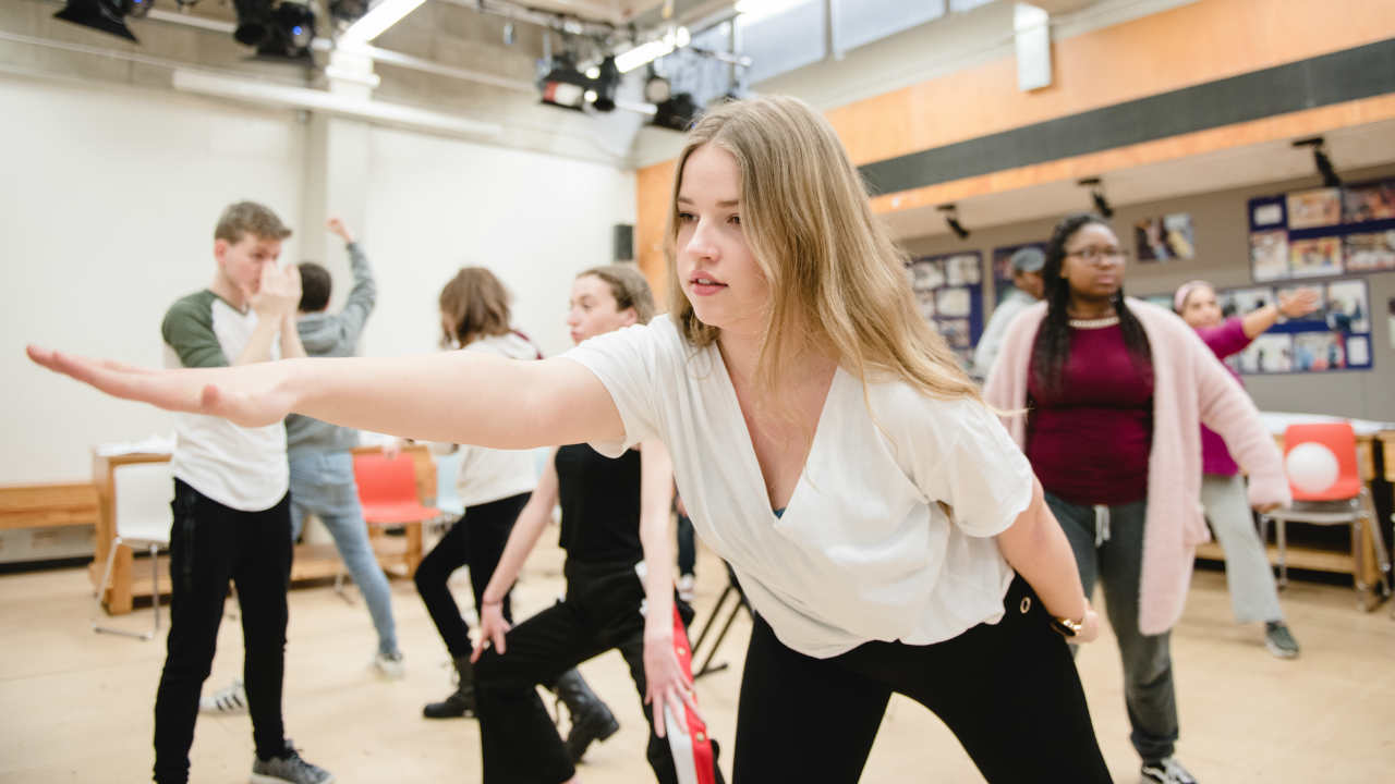 Young participants taking part in a movement workshop at the NT