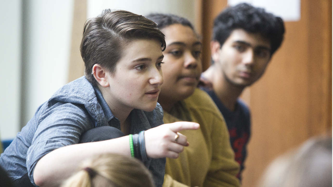 An Image of young people in a discussion