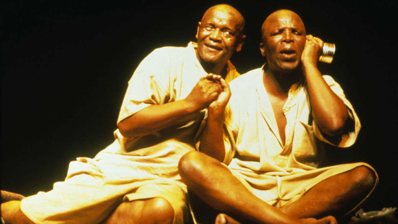 A production image of two actors performing in The Island (2000)