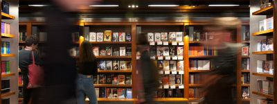 The Bookshop Playtext wall in the National Theatre, with customers browsing