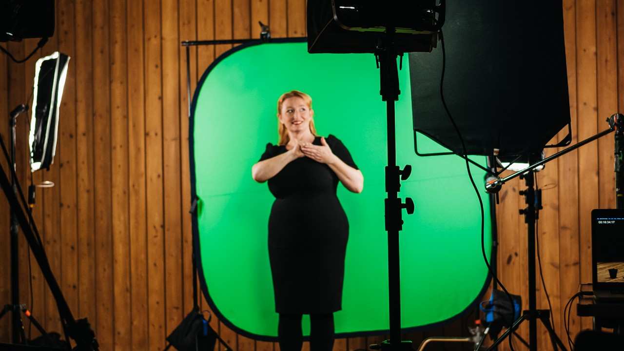 BSL recording in front of a green screen