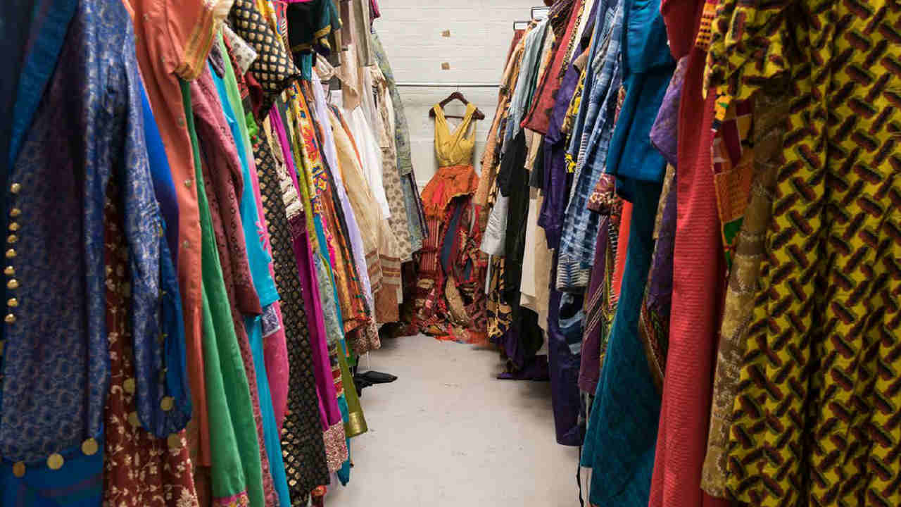 A photo of rows of costume racks