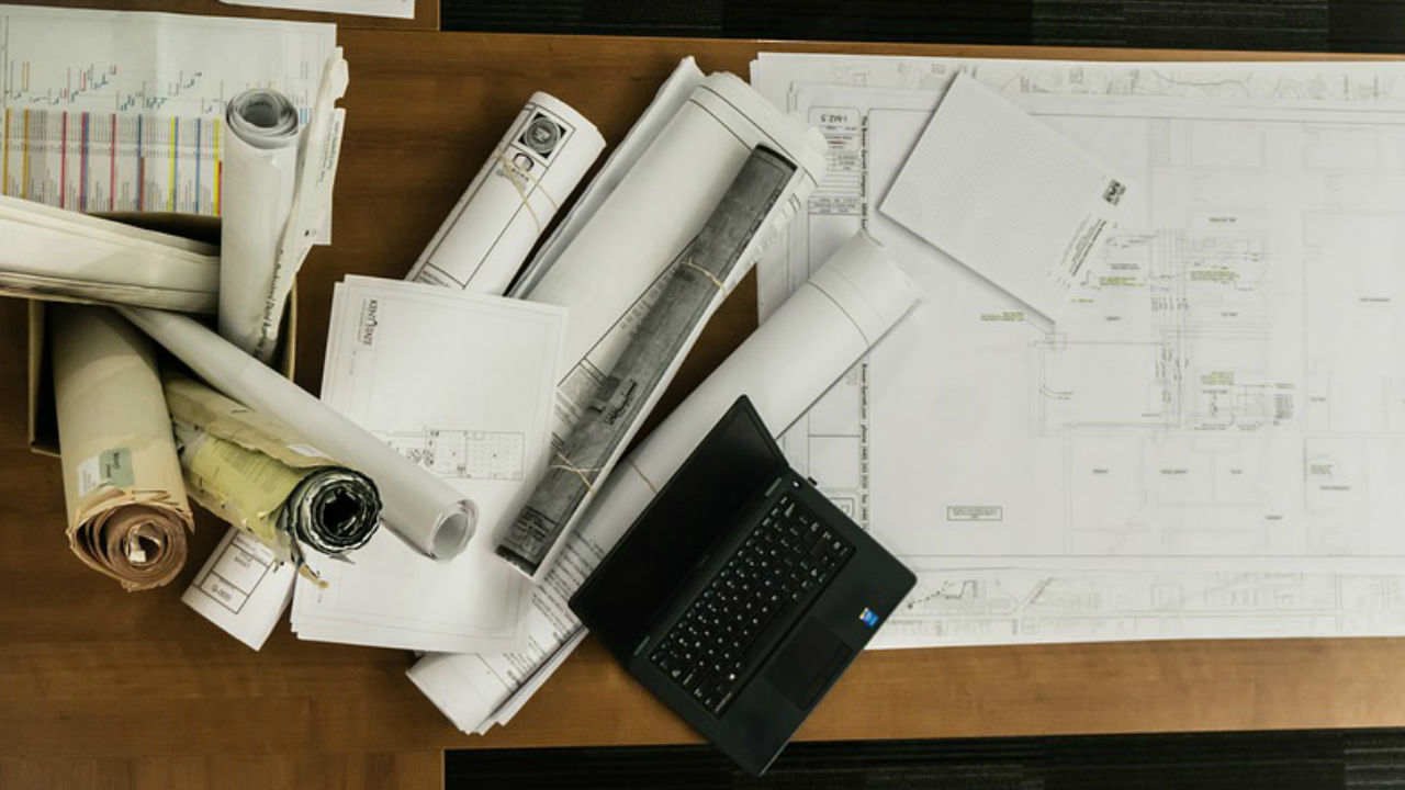 An image of design plans, floor plans and scrolls