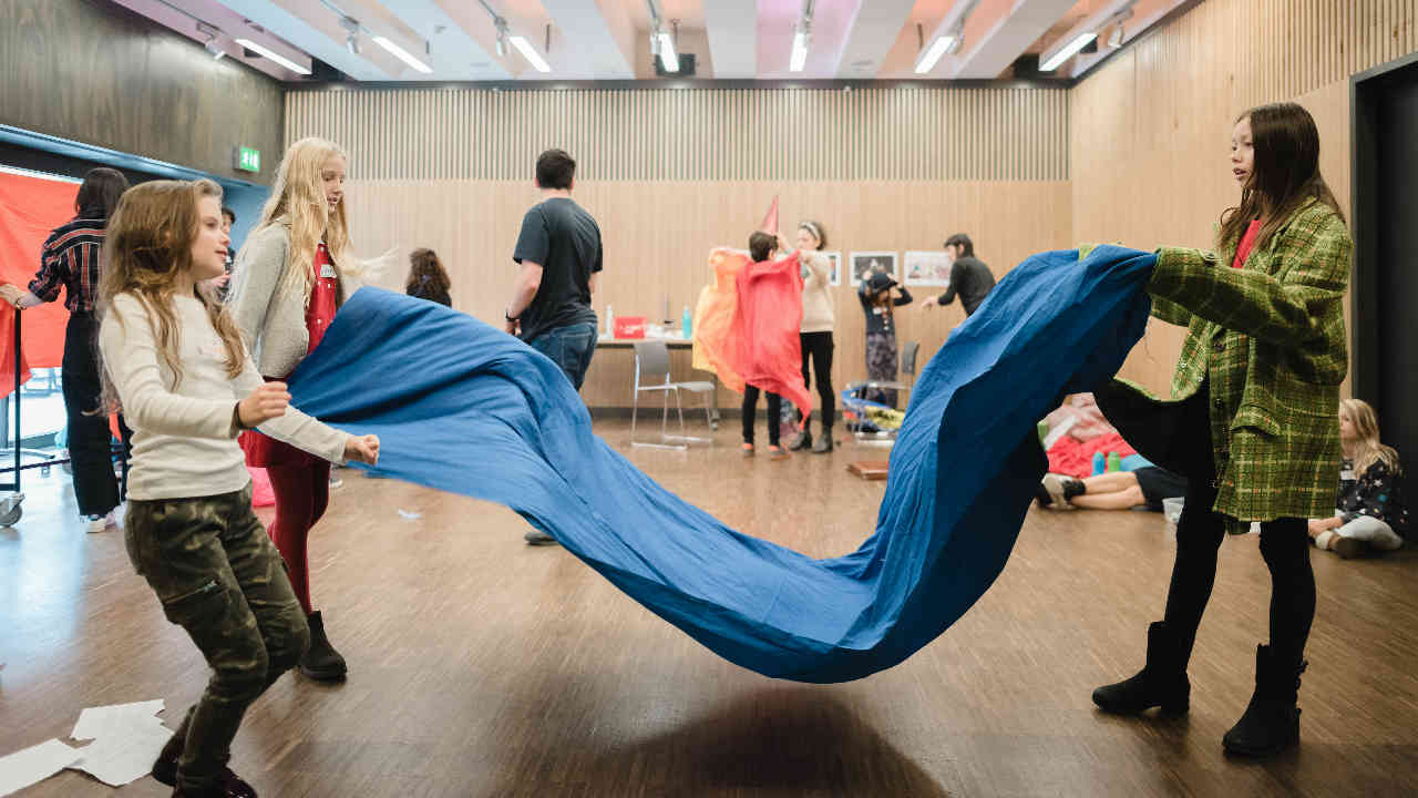 Young people taking part in practical family theatre workshop