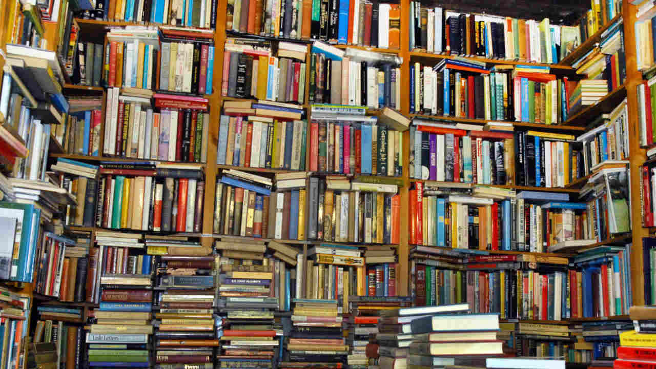 An image of lots of books stacked on shelves