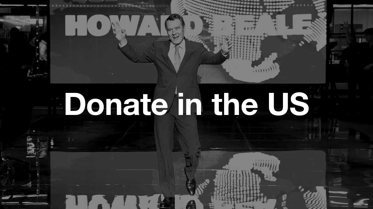 Donate in the US: text (Donate in the US) overlaid on a black and white photo of Bryan Cranston in Network