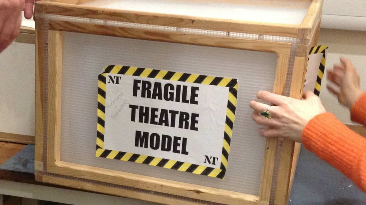 A box with the label 'Fragile Theatre Model'