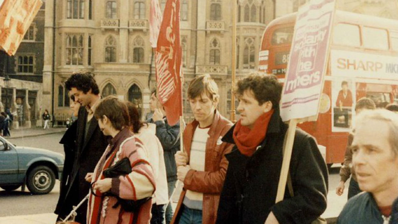 A photo of 1980s london showing protestors with plackards