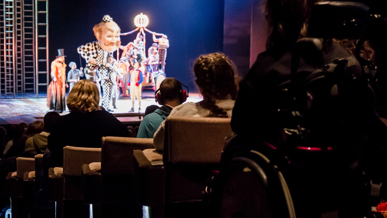 Audience members enjoying a relaxed performance of Pinocchio