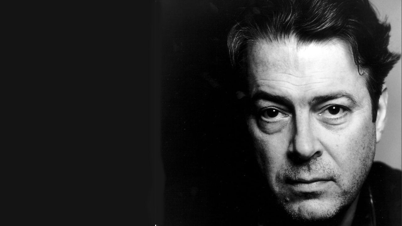 Head shot image of actor Roger Allam