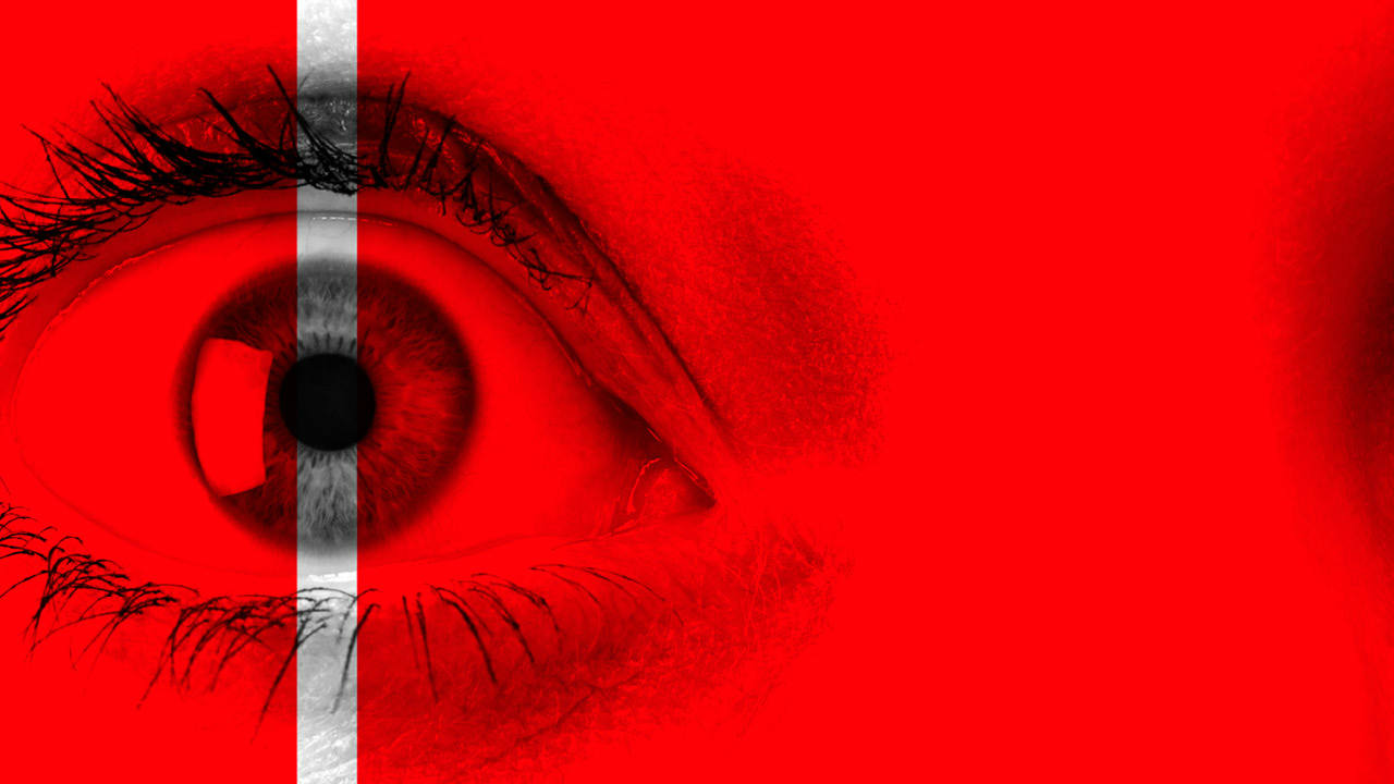 The Tell-Tale Heart marketing image, a red background with a close up of an eye with a white line through