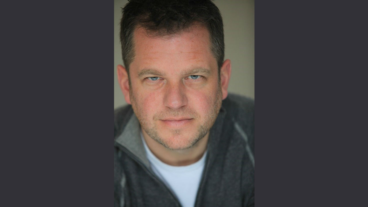 A head shot of author Adam Russ