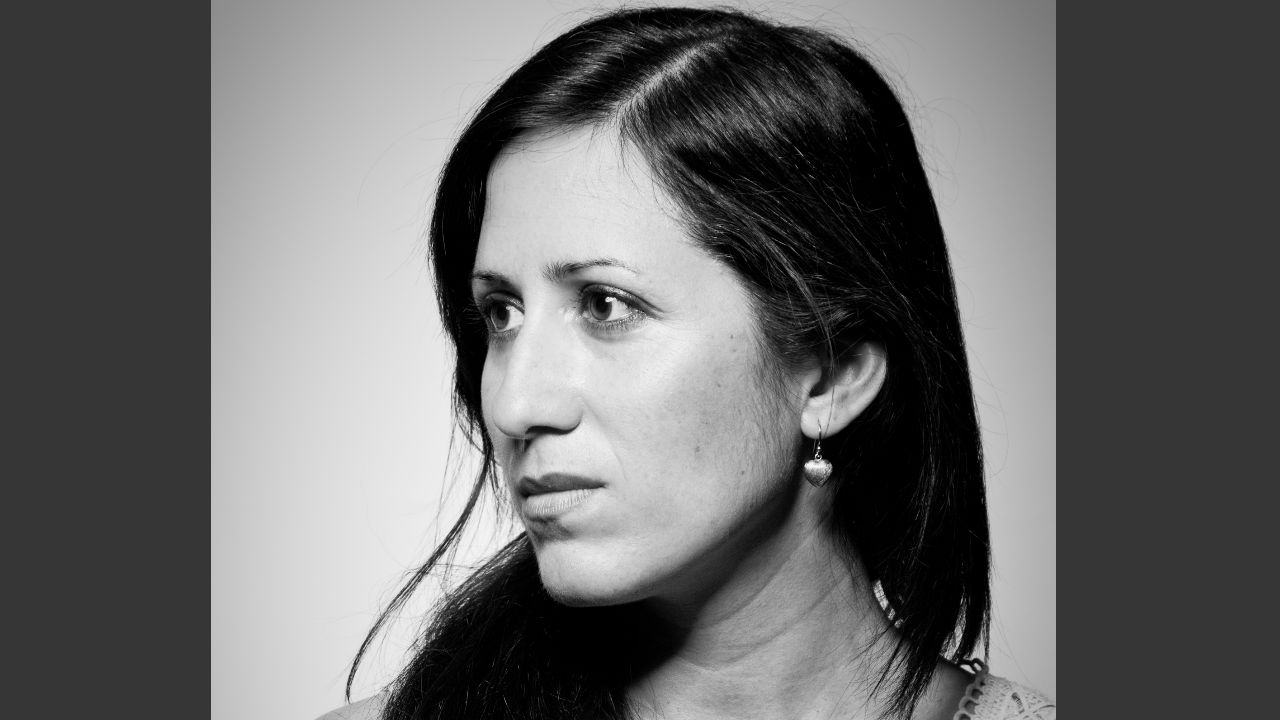 This is a photograph of Ursula Rani Samra looking away from the camera