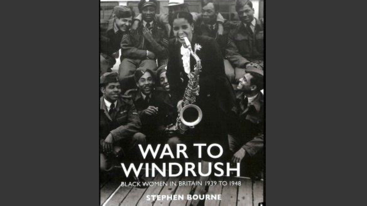 The cover of the book 'War to Windrush' including the title text over a photograph of a black woman playing the saxophone, with a group of soldiers watching