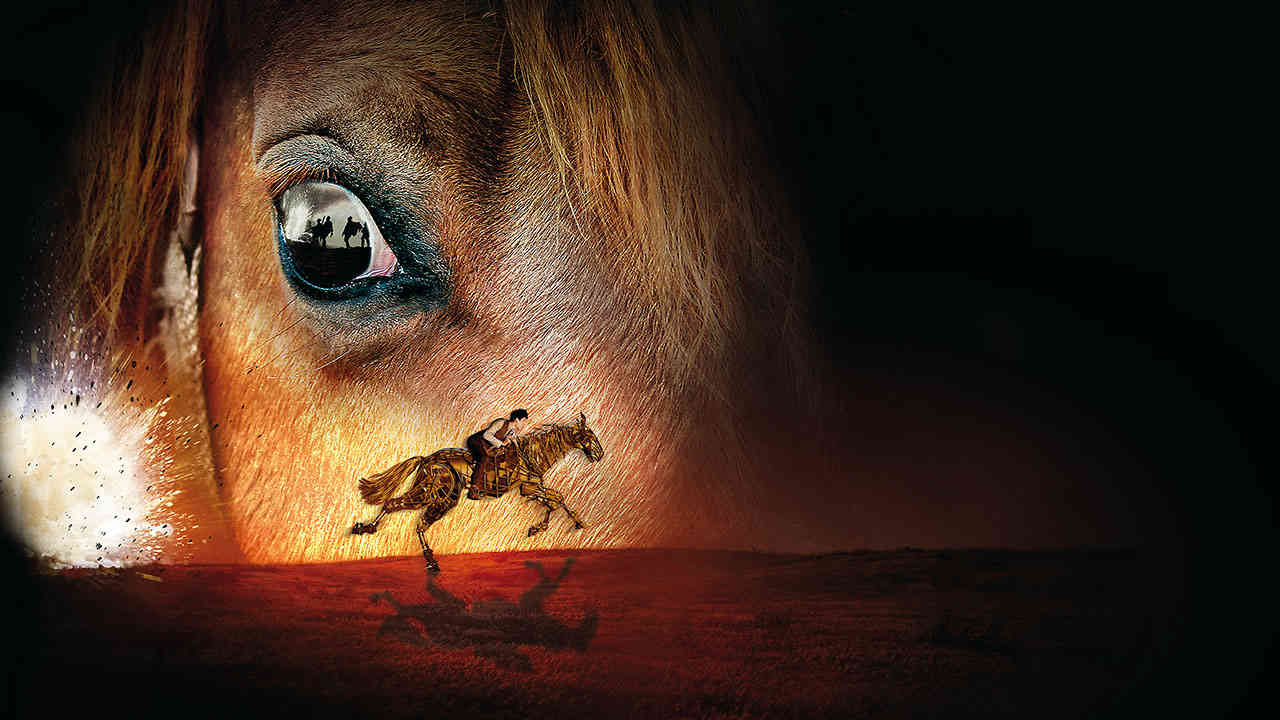 The marketing image for War Horse, close up image of a brown horses' face, with an image of the puppet horse riding in front