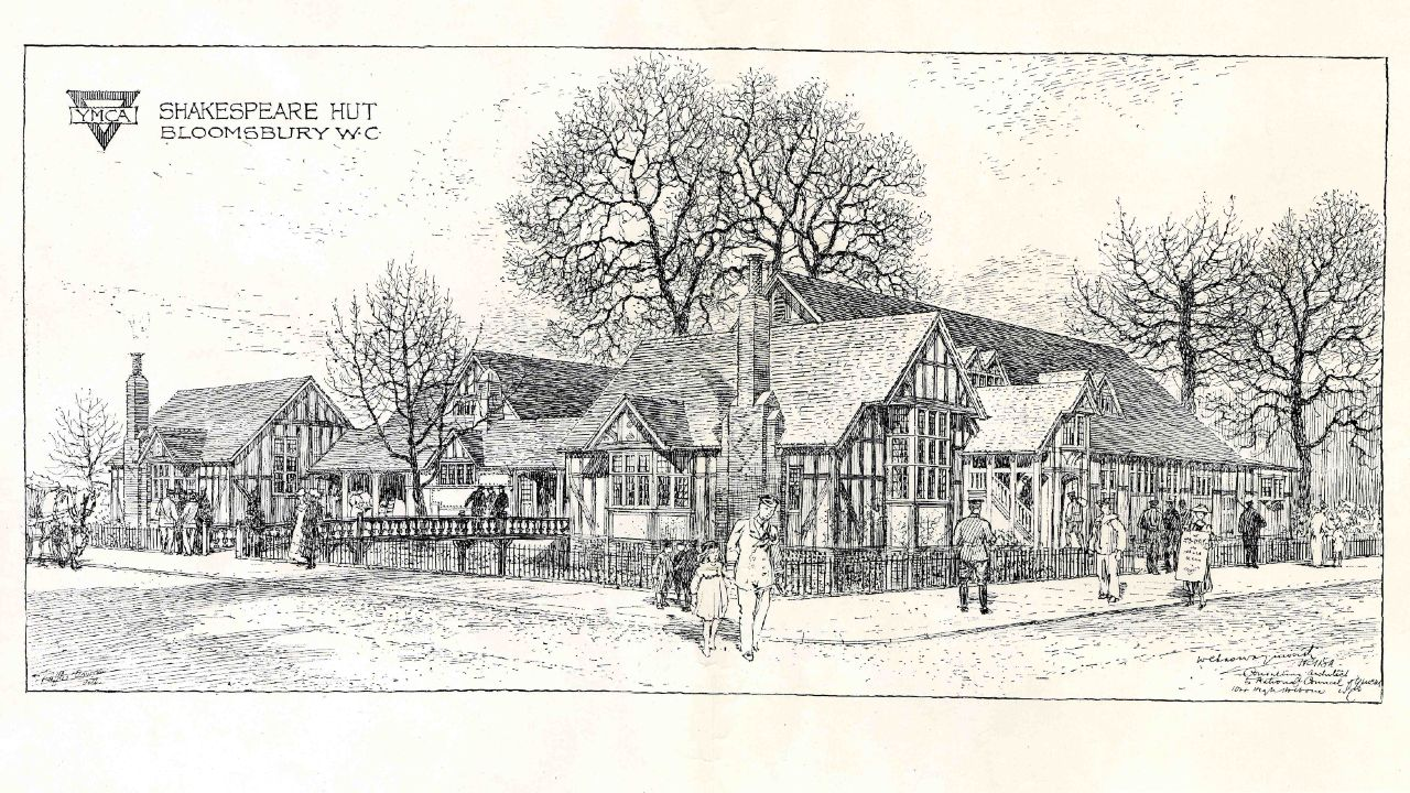 A black ink printed image of The Shakespeare Hut (an Arts and Crafts style set of buildings), Bloomsbury, WC, with a YMCA logo in the top left corner