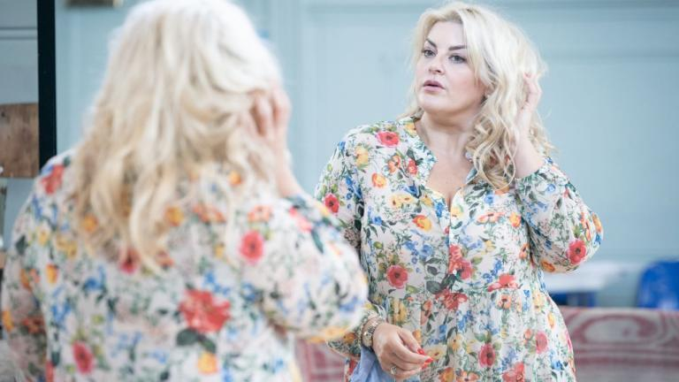 A Taste of Honey tour rehearsal image with Jodie Prenger looking in a wall mirror