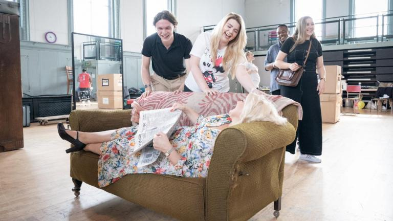 A Taste of Honey tour rehearsal image - company members and a sofa