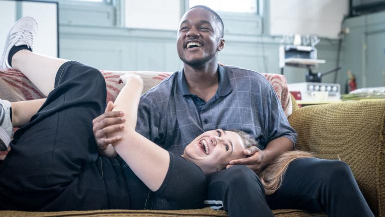 A Taste of Honey tour rehearsal image - company members on a sofa, laughing