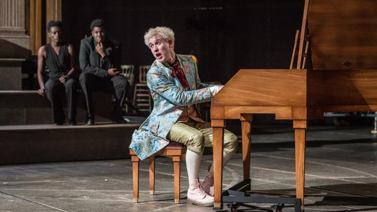 Adam Gillen as Wolfgang Amadeus Mozart, background Sarah Amankwah, Hammed Animashaun as Venticelli.
