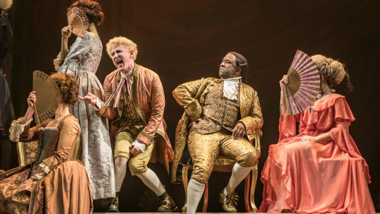 Adam Gillen as Wolfgang Mozart and Lucian Msamati as Antonio Salieri in Amadeus at the National Theatre (c) Marc Brenner