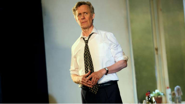 Image of Robin (Alex Jennings). He is stood clasping his hands and has a concerned expression on his face.
