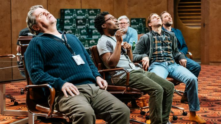 Stuart McQuarrie, Fisayo Akinade, Arthur Darvill and Hadley Fraser sat on chairs look up with open mouths.