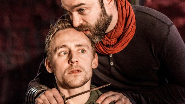 NT at Home Coriolanus production image of Tom Hiddleston as Coriolanus and Hadley Fraser as Aufidius
