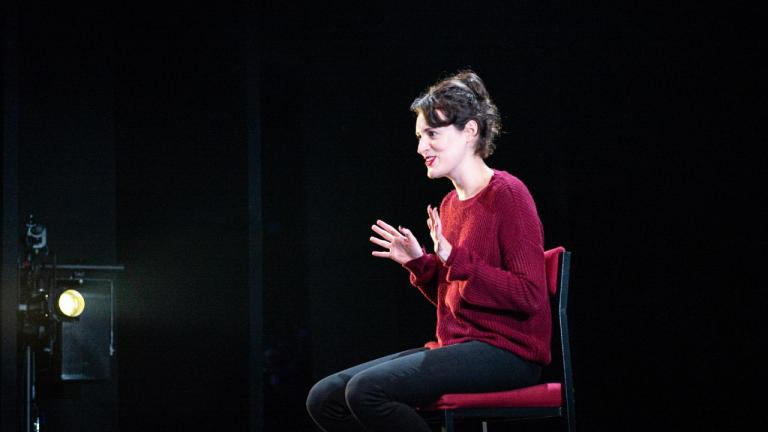 Fleabag with Phoebe Waller-Bridge sitting on a chair facing left