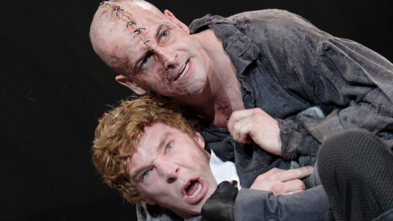 Frankenstein production photo Jonny Lee Miller as The Creature and Benedict Cumberbatch as Victor Frankenstein