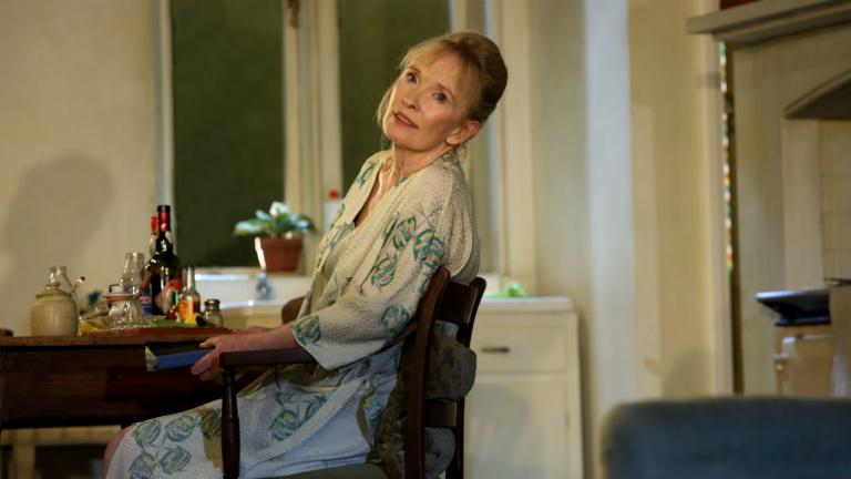 Image of Diana (Lindsay Duncan) sat at the kitchen table