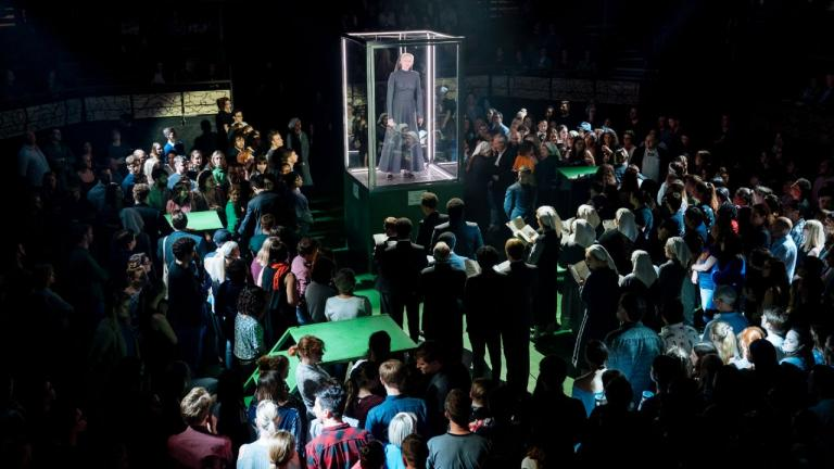 A Midsummer Nights Dream with Gwendoline Christie as Titania on a raised stage surrounded by audience members
