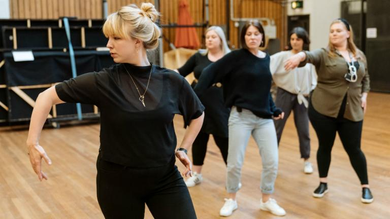 Peter Gynt rehearsal image with Polly Bennett (Movement Director) and company members