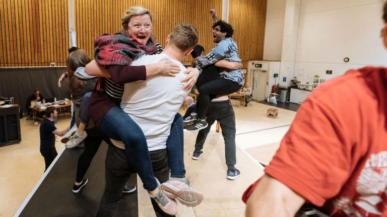 Peter Gynt rehearsal image with Isabelle Joss and company members