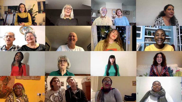 A diverse group of people are captured singing together on Zoom.