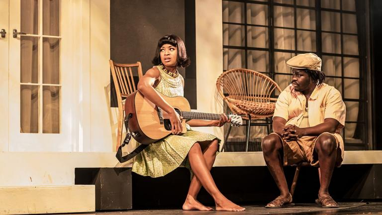 Racheal Ofori (Udo) and Adedeji Adetayo (Chidi, Guitarist) on the verandah in Three Sisters