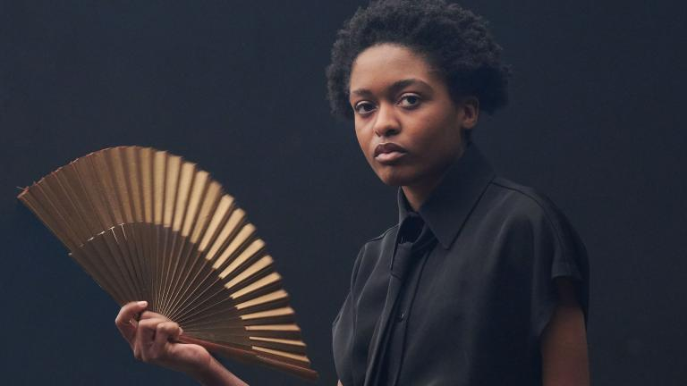 Romeo and Juliet production image with Ella Dacres holding an opened fan