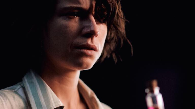 Romeo and Juliet production image with Jessie Buckley being offered a vial of potion.