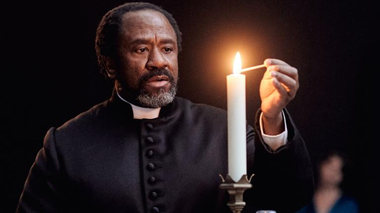 Romeo and Juliet production image with Lucian Msamati