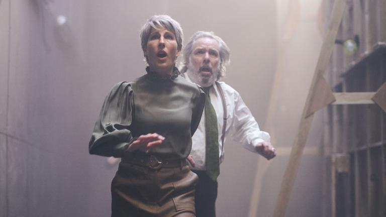 Romeo and Juliet production image with Tamsin Greig and Lloyd Hutchinson running towards camera, worried looks on their faces