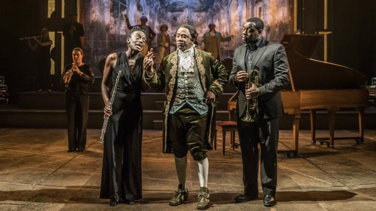 Sarah Amankwah as Venticelli Lucian Msamati as Antonio Salieri and Ekow Quarty as Venticelli in Amadeus at the National Theatre (c) Marc Brenner