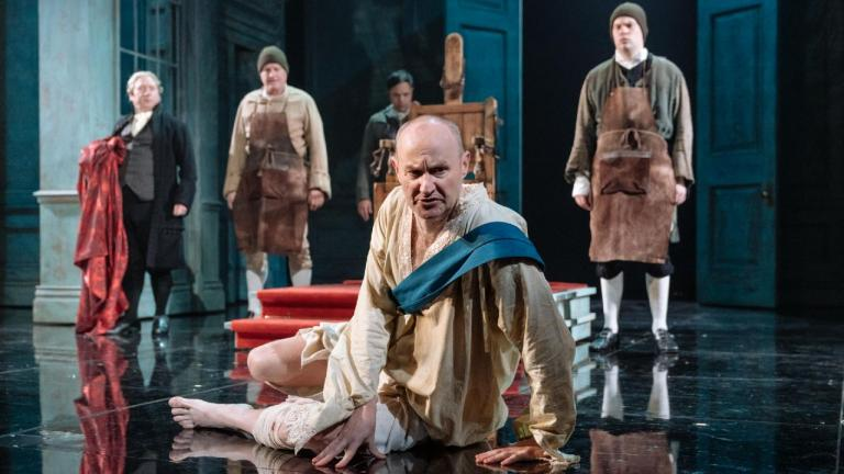 The Madness of George III - the King lies on the floor, surrounded by staff