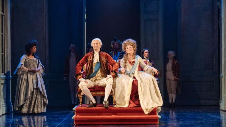 The Madness of George III - The King and Queen on thrones upon a dias, with courtiers around them