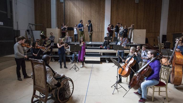 Southbank Sinfonia in rehearsals for Amadeus, featuring Paddy [front right, purple jumper] and Oli is [background, red trainers].