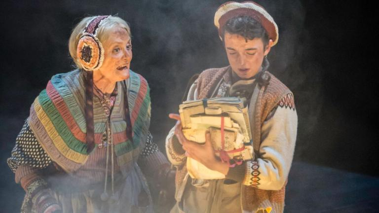 Treasure Island production image - Grandma and Jim looking at the contents of Bill Bones' chest