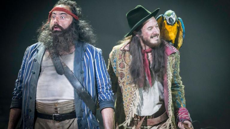 Treasure Island production image - Long John Silver, his parrot on his shoulder, and a member of his crew
