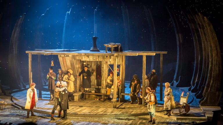 Treasure Island production image -the Treasure Island company in and around a wooden shack